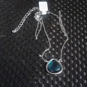 Boxed Teal crystal silvertone pendant.